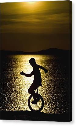 Unicycling Silhouette Canvas Print by Deddeda