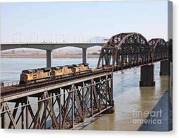 Union Pacific Locomotive Trains Riding Atop The Old Benicia-martinez Train Bridge . 5d18850 Canvas Print by Wingsdomain Art and Photography
