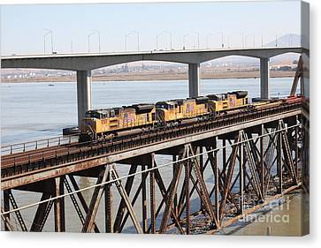 Union Pacific Locomotive Trains Riding Atop The Old Benicia-martinez Train Bridge . 5d18851 Canvas Print by Wingsdomain Art and Photography