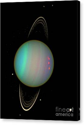 Uranus With Moons Canvas Print by Nasa