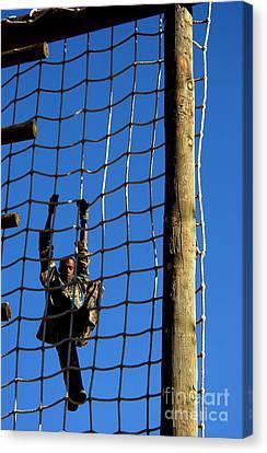 U.s. Air Force Airman Climbing Net Canvas Print by Stocktrek Images