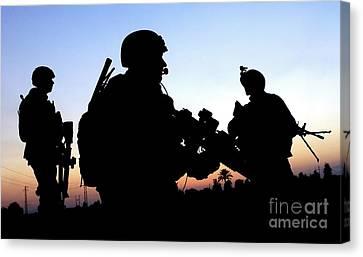 U.s. Air Force Members Conduct A Patrol Canvas Print by Stocktrek Images