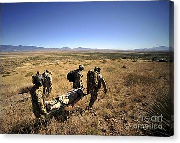 U.s. Air Force Pararescuemen Carry Canvas Print by Stocktrek Images
