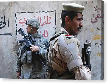 Us And Iraqi Army Soldiers Stand Guard Canvas Print by Everett