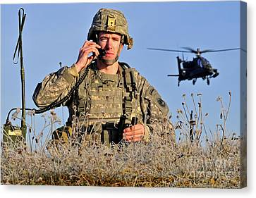 U.s. Army Captain Directs An Ah-64 Canvas Print by Stocktrek Images