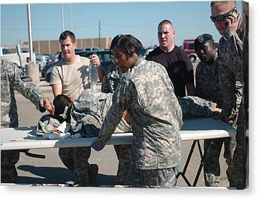 Us Army First Responders Use A Table Canvas Print by Everett