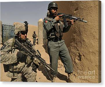 U.s. Army Soldier And An Afghan Canvas Print by Stocktrek Images