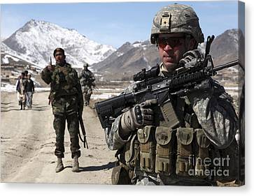 U.s. Army Soldier Conducts A Patrol Canvas Print by Stocktrek Images