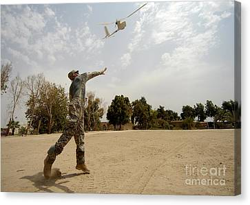 U.s. Army Soldier Launches An Rq-11b Canvas Print by Stocktrek Images