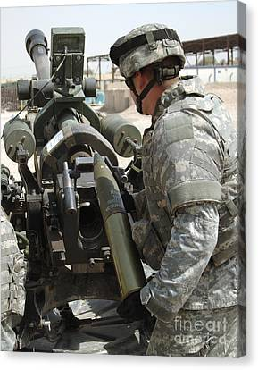 U.s. Army Soldier Loads A 105mm Canvas Print by Stocktrek Images