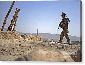 U.s. Army Soldier On A Foot Patrol Canvas Print by Stocktrek Images