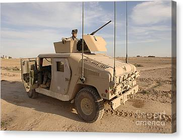 M1114 Canvas Print - U.s. Army Soldier Pulls Security On Top by Stocktrek Images