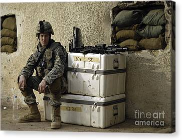 U.s. Army Soldier Relaxing Before Going Canvas Print by Stocktrek Images