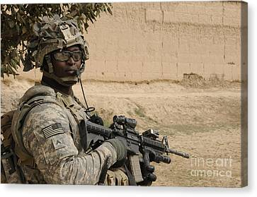 U.s. Army Soldier Scans His Area While Canvas Print by Stocktrek Images
