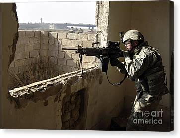 U.s. Army Soldier Searching Canvas Print by Stocktrek Images