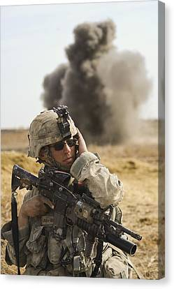 U.s. Army Soldier With Covers His Ear Canvas Print