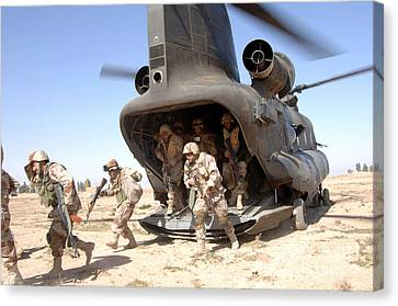 Iraq Canvas Print - U.s. Army Soldiers Disembark A Ch-47 by Stocktrek Images