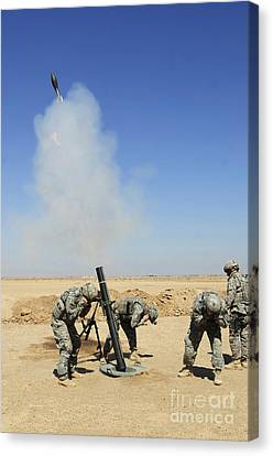 U.s. Army Soldiers Firing An M120 120mm Canvas Print by Stocktrek Images