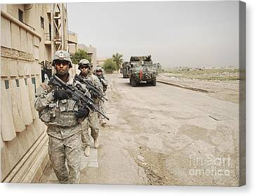 U.s. Army Soldiers Moving To Their Next Canvas Print by Stocktrek Images