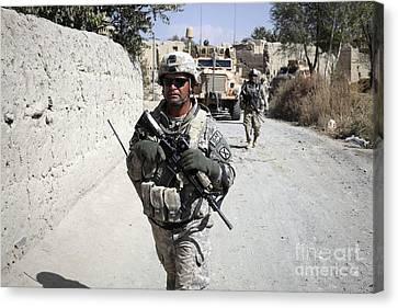 U.s. Army Soldiers On A Foot Patrol Canvas Print by Stocktrek Images