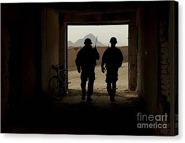 U.s. Army Soldiers Patrol A Village Canvas Print by Stocktrek Images
