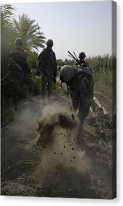 Us Army Soldiers Search For Buried Canvas Print by Everett