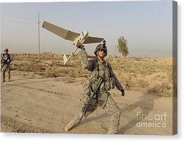 Baghdad Canvas Print - U.s. Army Specialist Launches An Rq-11 by Stocktrek Images