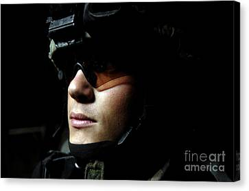 U.s. Army Specialist Waits To Dismount Canvas Print by Stocktrek Images