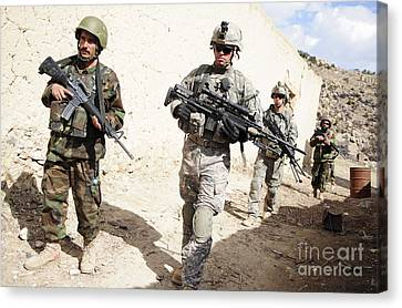 U.s. Army Troops Lead A Patrol Canvas Print by Stocktrek Images