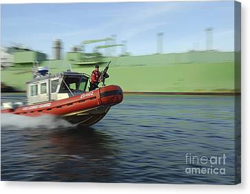 U.s. Coast Guard Officer Mans A M240b Canvas Print by Stocktrek Images