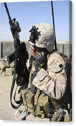 U.s. Marine Communicates With Fellow Canvas Print by Stocktrek Images