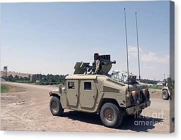 M1114 Canvas Print - U.s. Marine Pulls Security On Top by Stocktrek Images