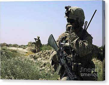 U.s. Marine Uses A Radio Canvas Print by Stocktrek Images