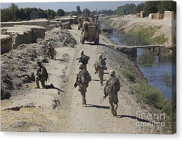 U.s. Marines Conduct A Security Patrol Canvas Print by Stocktrek Images