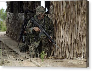 U.s. Marines Prepare To Enter A House Canvas Print by Stocktrek Images