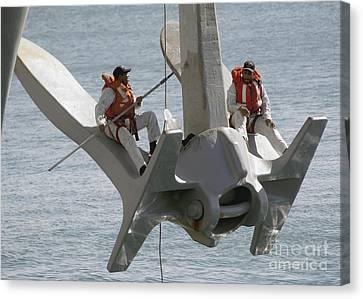 U.s. Navy Servicemen Apply A Coat Canvas Print by Stocktrek Images