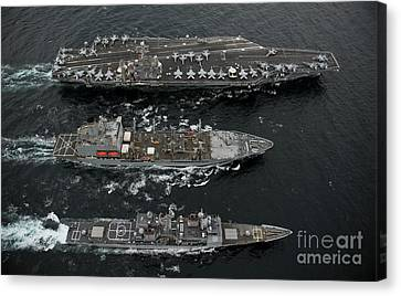 U.s. Navy Ships Conduct A Replenishment Canvas Print by Stocktrek Images