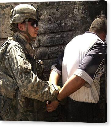 Us Soldier Cuffs An Iraqi Man Suspected Canvas Print by Everett
