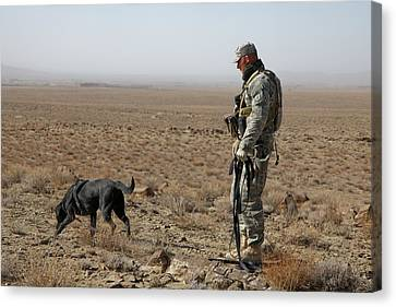 Working Dog Canvas Print - Us Soldier Works With A Dog Identified by Everett
