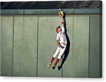 Usa, California, San Bernardino, Baseball Player Making Leaping Catch At Wall Canvas Print by Donald Miralle