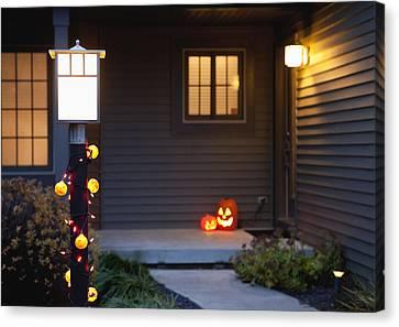 Usa, Illinois, Metamora, Jack O' Lanterns On Porch Canvas Print by Vstock LLC