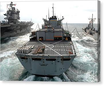 Usns Supply Conducts A Replenishment Canvas Print by Stocktrek Images