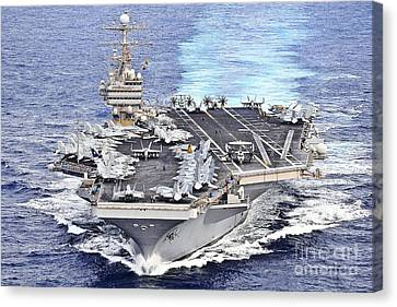 Uss Abraham Lincoln Transits Canvas Print by Stocktrek Images