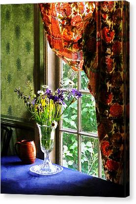 Vase Of Flowers And Mug By Window Canvas Print by Susan Savad