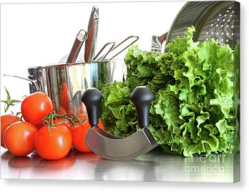 Vegetables With Kitchen Pots And Utensils On White  Canvas Print by Sandra Cunningham