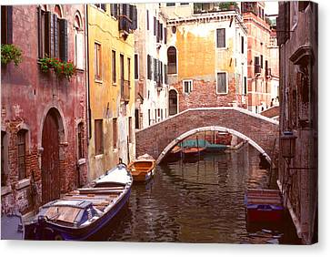 Canvas Print featuring the photograph Venice Bridge Over A Small Canal. by Tom Wurl
