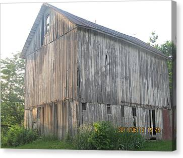 Canvas Print featuring the photograph Very Old Barn by Tina M Wenger