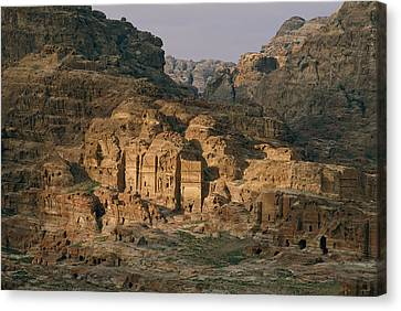 View Of A Number Of Nabataean Tombs Canvas Print by Annie Griffiths
