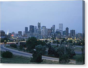 View Of The Denver Skyline At Twilight Canvas Print by Richard Nowitz