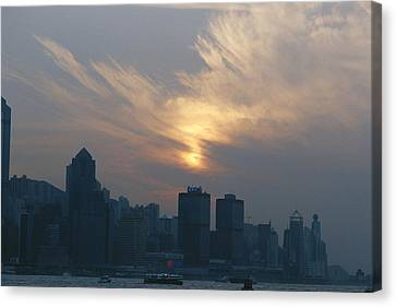 View Of The Hong Kong Skyline At Sunset Canvas Print by Raul Touzon